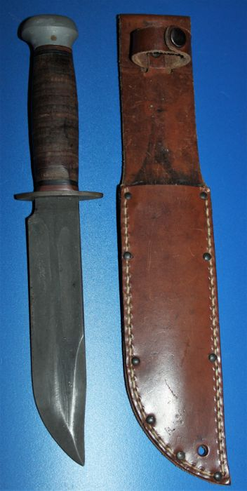 World war II US Army RH Pal 36 fighting knife, with leather scabbard, and marking on ricasso, in good condition