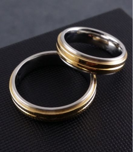 1 pair gold-/gemstone rings - 750 yellow gold/stainless steel - size 72/61