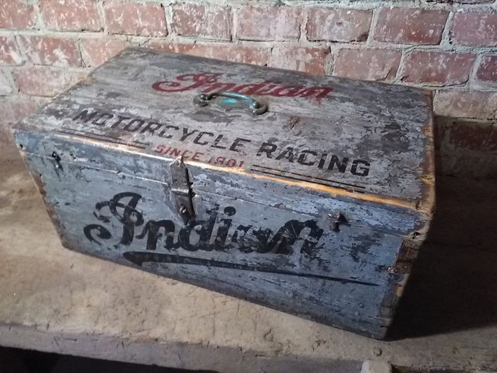 Old garage style crate with INDIAN prints on lid and front side