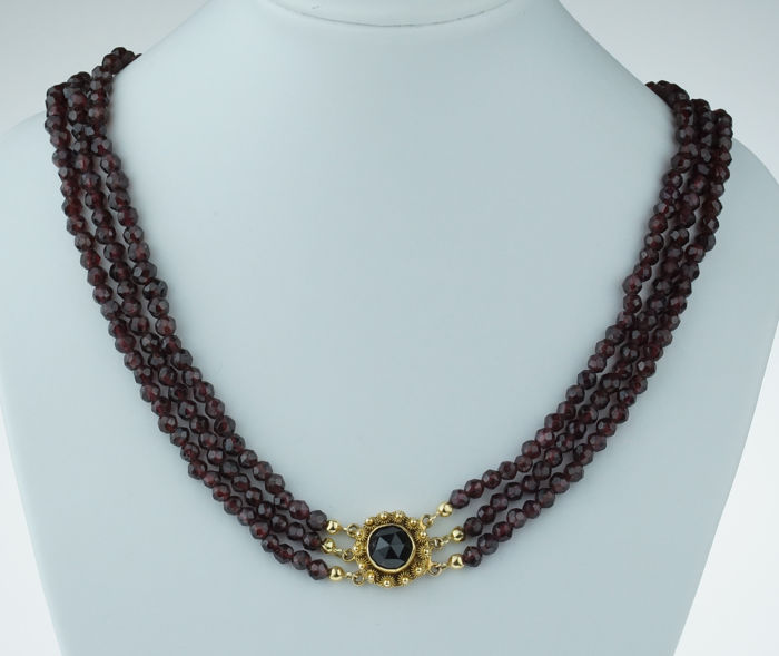 3 stranded garnet necklace with elegant 14 kt gold clasp - local item of jewellery