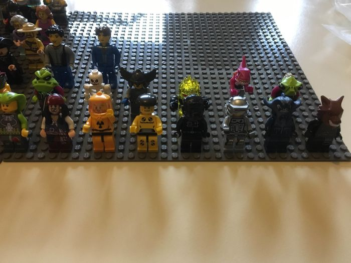 Assorted Lego mini figures 87 pieces and accessories