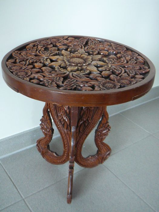 Solid wooden side table with Oriental wood carvings