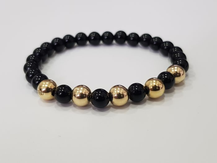 18 kt gold bracelet with natural polished onyx