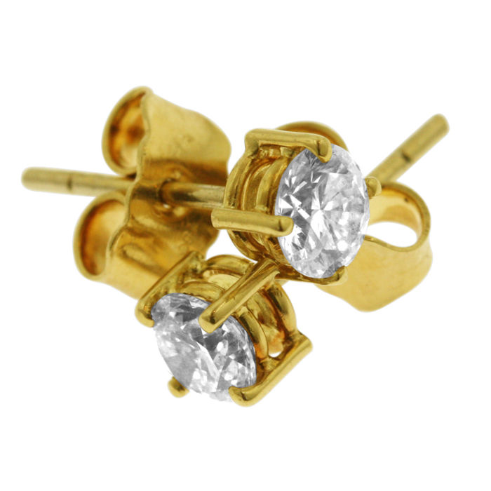 18K gold  0.64ct Diamond Studs, as new.