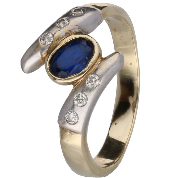 14 kt - Yellow gold ring set with 6 brilliant cut diamonds of approx. 0.12 ct and an oval-cut synthetic sapphire in a white gold setting - Ring size: 17.75