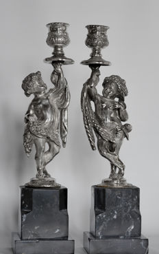 """Estate e Primavera"" Pair of silver candle holders with allegorical figures. Naples, early 20th century"