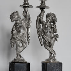 """""""Estate e Primavera"""" Pair of silver candle holders with allegorical figures. Naples, early 20th century"""