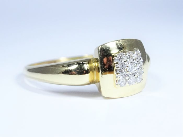 18kt Gold Ring of 3,9g set with 9 Diamonds - Size 19/60