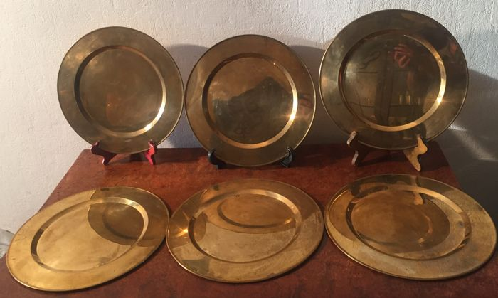 6 heavy gold plated decorative plates.