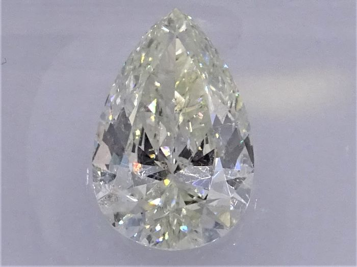 Prachtige 1.69 ct. pear geslepen diamant - Tinted white (L) - SI2