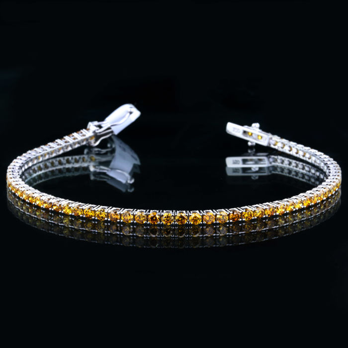 Tennis Bracelet With Natural Fancy Deep Orangy Yellow Diamond 18K White Gold