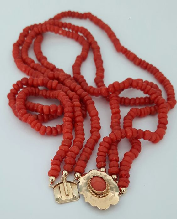 Three strands of 100% antique precious coral with an antique 14 karat gold clasp