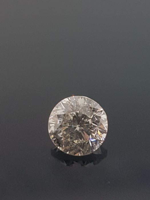 Certified 0.94 Carat Round Diamond SI2/J