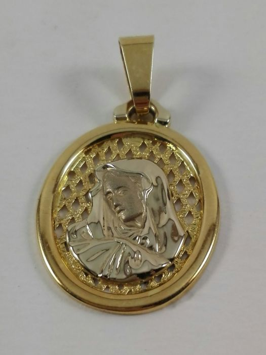 Women's pendant in 18 kt white and yellow gold. Weight: 4.5 g