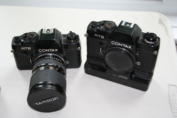 complete Contax outfit - 2 RTS bodies , power  wind , 6 lenses, filters and flash gun,padded carrying case