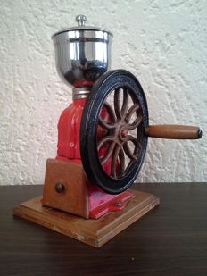 Large cast iron coffee grinder with rotary wheel