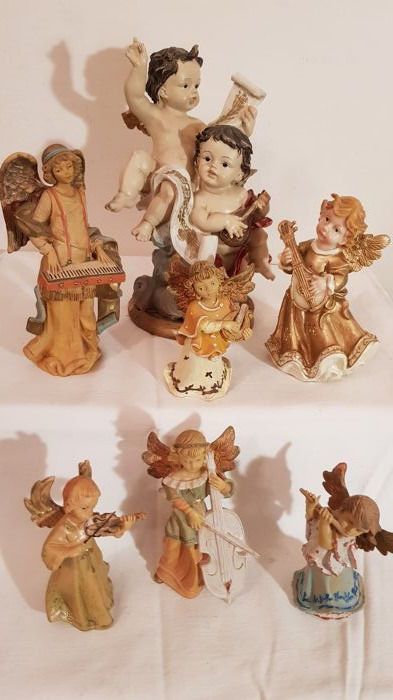 Interesting lot of 7 guardian angels with musical instruments