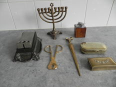 1 tobacco box 2 cigar cutters 1 table lighter (Ronson) 1 letter opener 1 stamp box 1 jewish candlestick