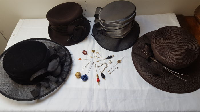 Twelve antique hat pins and four lady hats