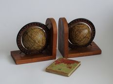 Old wooden bookends with globes with a rare mini atlas from 1940