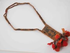 Indian Surinam necklace with red bird's feathers.
