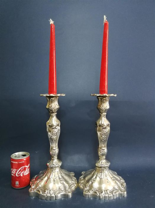 Sleek pair of English silver plated candlesticks