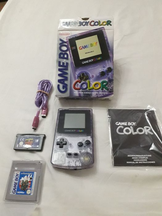 Game boy color - boxed with 2 games Ghostbusters II and Mario Donkey Kong for game boy advance