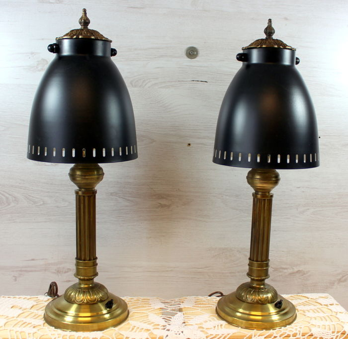 A pair of copper column shaped table lamps with black metal hoods. Height: 61 cm. 20th century, the Netherlands