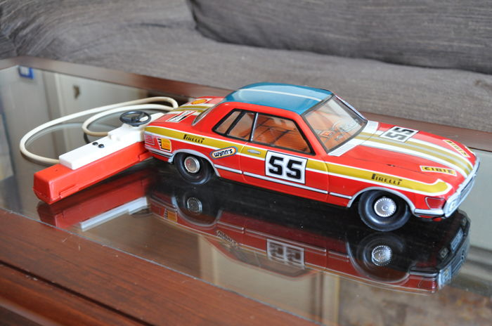 Tinplate Mercedes 350 SL from 1970 and electric radio-controlled MG from 1970
