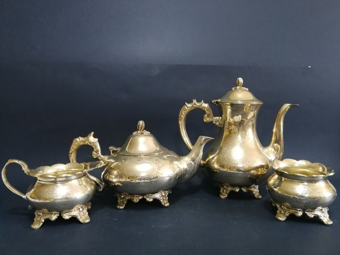 Nice richly decorated 4-piece silver plated tea set