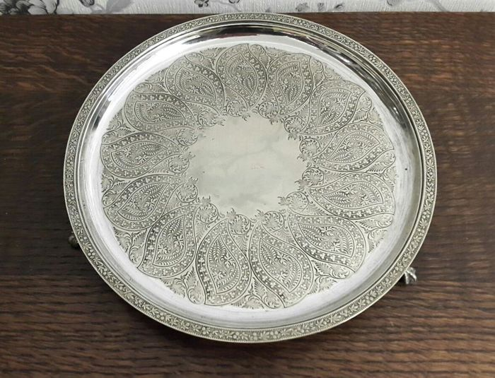 Nice silver plated round tray finely engraved with eagle feet