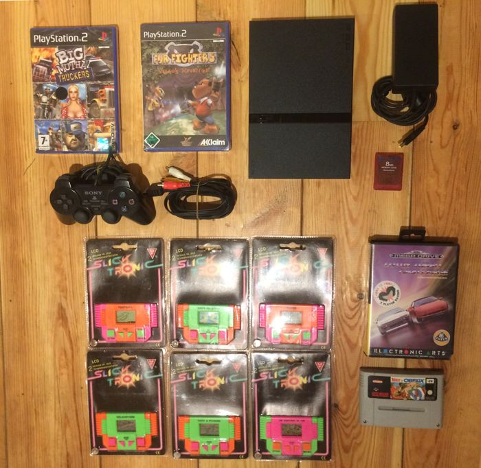 PS2 console complete with games and big bundle of retro games