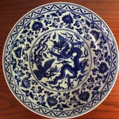 Jingdezhen hand-painted blue and white large porcelain plate decorated with dragon, phoenix and flowers - China - late 20st century