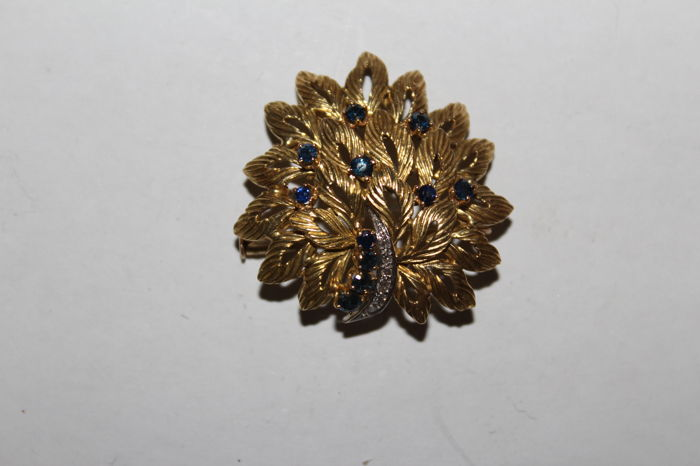 18 kt gold brooch with sapphires and diamonds