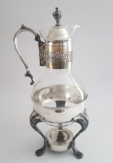 Coffee decanter with silver plated frame on a silver plated warming holder