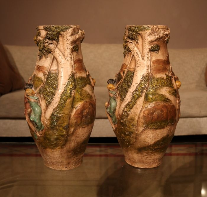 A Pair Of Vases In Baked White Terra Cotta With Romantic Scenes