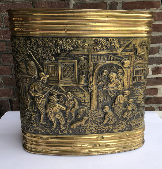 Large antique umbrella stand of brass with old Dutch scenes
