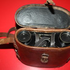 Pair of WWII Air Ministry Watson & Baker binoculars marked and dated 1943, in brown leather case,also marked, optics in fair condition