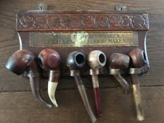 Beautiful hand-carved pipe rack with a nice saying