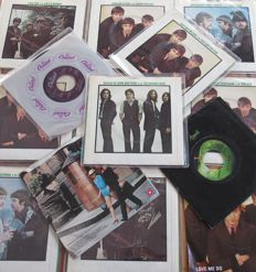 A rare collection of 14 Beatles and Beatles related 45 rpm vinyl singles