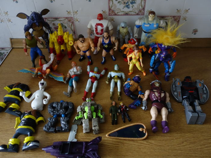 A large job lot of vintage action figures from the 80s and 90s
