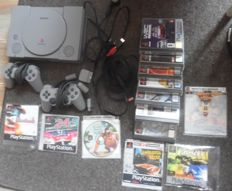 Sony ps 1 + 2 controllers + 13  games like DBZ  + Mickey + Jungle Book and more