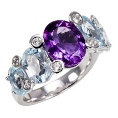 """""""Calla"""" ring, in 18 kt gold, with diamond and azure oval topazes and a central oval amethyst."""
