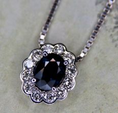 Vintage White gold 14kt./585 necklace with pendant set a natural blue Sapphire surrounded by Top quality brilliant cut Diamonds E/VVS1 ca. 1Ct. total.