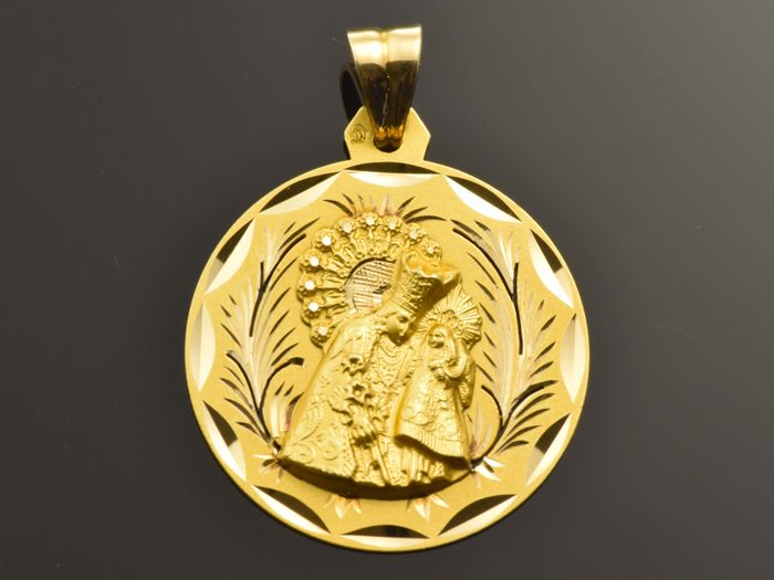 Religious pendant of 18 kt gold. Weight 6.72 g