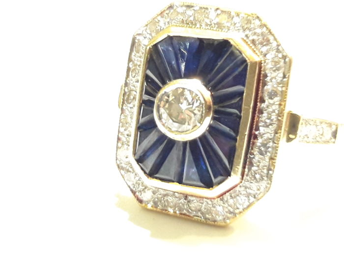 Gold ring Made in Italy with round cut diamonds and synthetic blue sapphires