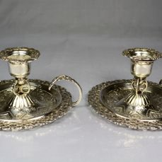 A pair of silver hand held candlesticks, London, 1896, by Josian Williams Jackson