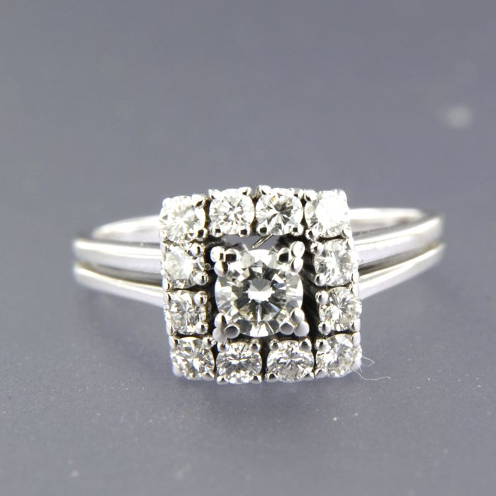 14 white-gold ring, set with 12 brilliant-cut diamonds of approx. 1.00 ct in total, ring size: 18 (57)