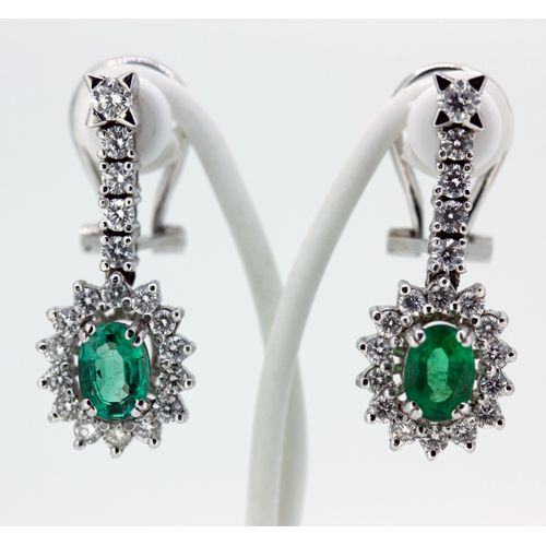 Long gold earrings, with emerald and diamonds.