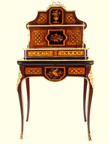 A Louis XV style marquetry bureau de dame, inlaid in different woods - France - late 19th century